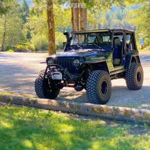"2002 Jeep Wrangler - 15x10 -50mm - Raceline Defender - Suspension Lift 5"" - 35"" x 12.5"""