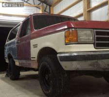 """1990 Ford Bronco - 15x8 -24mm - American Racing Outlaw - Stock Suspension - 31"""" x 10.5"""""""