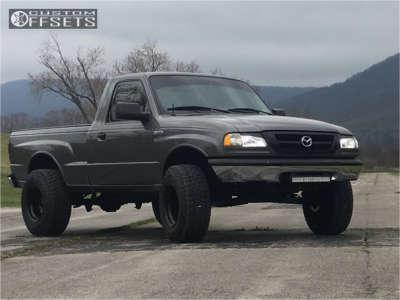 "1999 Mazda B2500 - 15x10 -44mm - Black Rock 997 - Suspension Lift 4"" - 31"" x 10.5"""