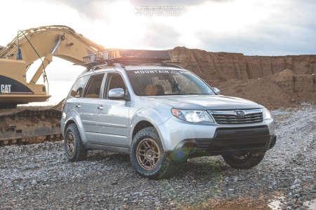 2010 Subaru Forester - 15x7 10mm - KMC Km716 - Leveling Kit - 215/75R15