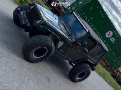 "2006 Jeep Wrangler - 15x10 -38mm - American Racing Outlaw Ii - Stock Suspension - 35"" x 12.5"""