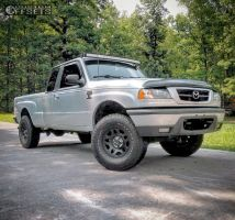 """2002 Mazda B4000 - 15x6 35mm - Spaced Out Stockers Spaced Out Stockers - Stock Suspension - 31"""" x 10.5"""""""