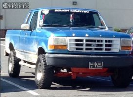 """1992 Ford F-150 - 15x7.5 31mm - Spaced Out Stockers Spaced Out Stockers - Suspension Lift 4"""" - 31"""" x 10.5"""""""