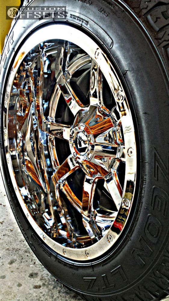 "2002 Chevrolet Silverado 1500 Aggressive > 1"" outside fender on 20x12 -44 offset Fuel Maverick & 305/50 Cooper Zeon LTZ on Suspension Lift 4"" - Custom Offsets Gallery"
