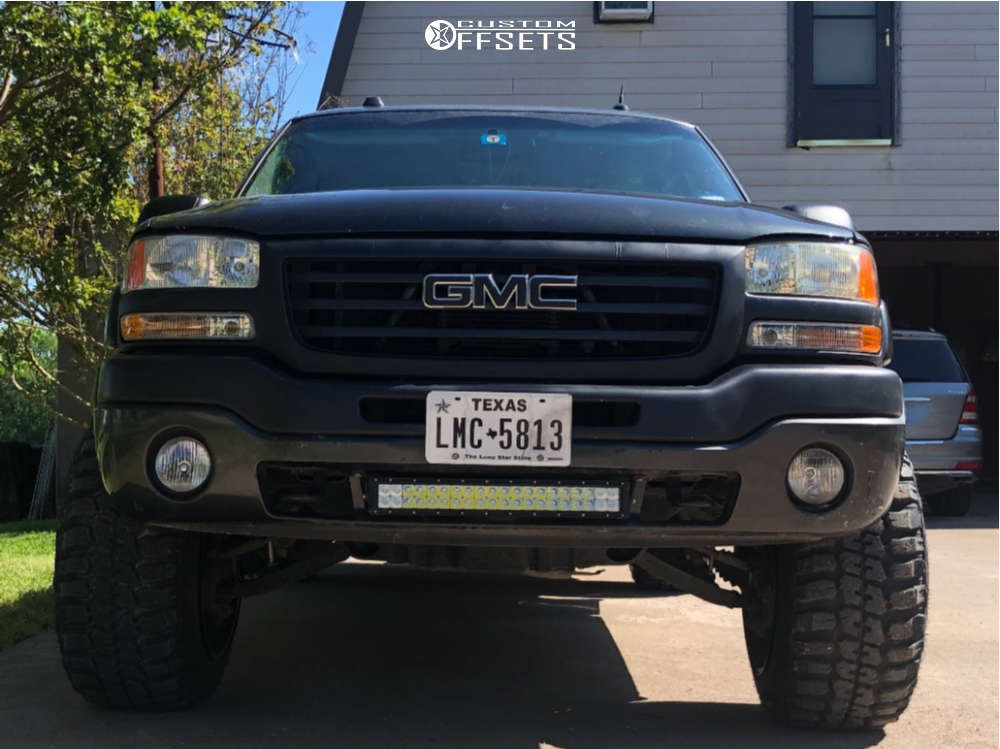 """2004 GMC Savana 1500 Hella Stance >5"""" on 20x14 -76 offset XD Buck and 33""""x12.5"""" Federal Couragia Mt on Suspension Lift 2.5"""" - Custom Offsets Gallery"""
