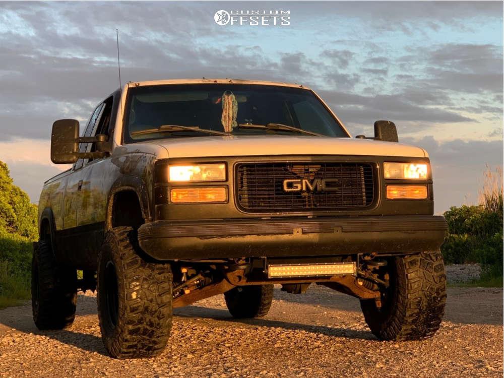 "1996 GMC K1500 Aggressive > 1"" outside fender on 15x10 -44 offset Black Rock D Widow & 33""x12.5"" Cooper Discoverer Stt Pro on Suspension Lift 3"" - Custom Offsets Gallery"