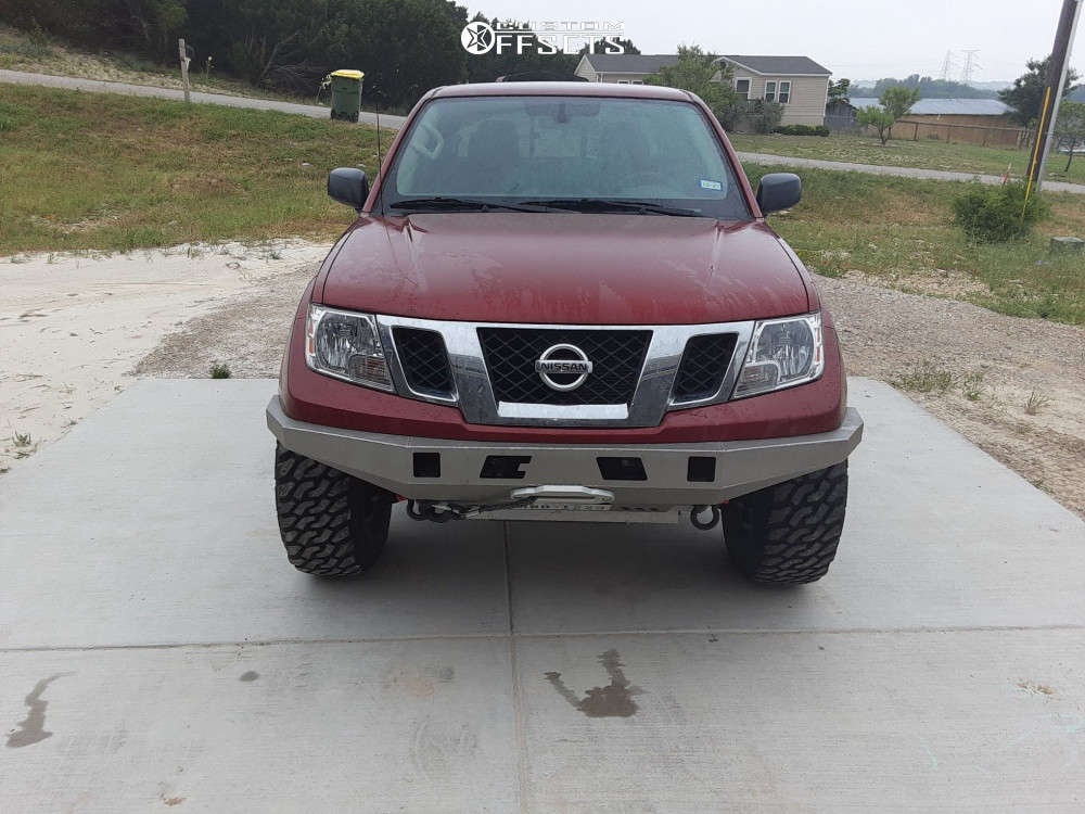"""2019 Nissan Frontier Aggressive > 1"""" outside fender on 17x8 -12 offset Pro Comp Series 89 and 305/70 Leao Lion Sport M/t on Suspension Lift 3"""" - Custom Offsets Gallery"""