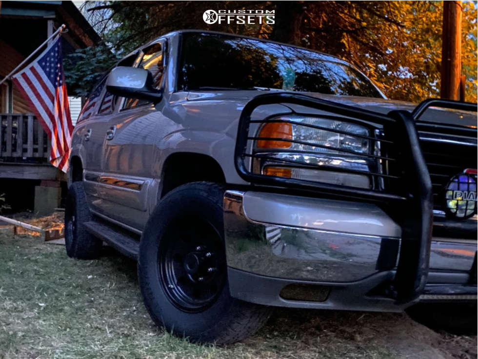 """2004 GMC Yukon Slightly Aggressive on 16x10 -25 offset American Racing Ar172 and 32""""x10.5"""" Trail Guide All Terrain on Stock Suspension - Custom Offsets Gallery"""