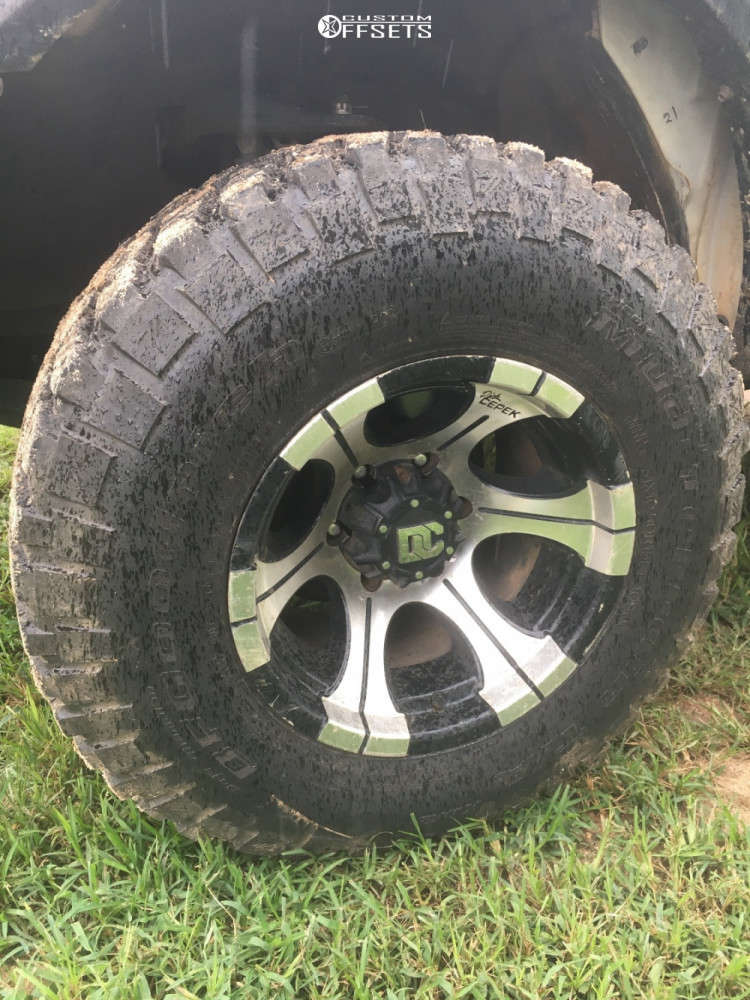 """1999 Toyota Tacoma Aggressive > 1"""" outside fender on 15x10 -24 offset Dick Cepek Dc-2 and 275/65 BFGoodrich M/t Km2 on Stock Suspension - Custom Offsets Gallery"""