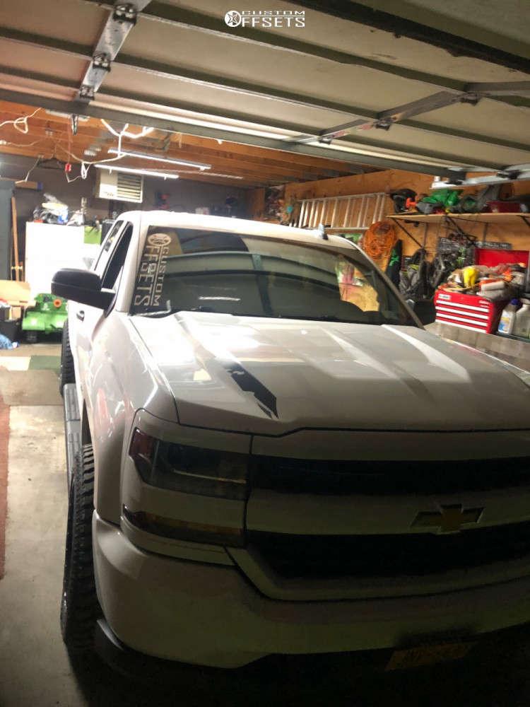 "2016 Chevrolet Silverado 1500 Aggressive > 1"" outside fender on 20x10 -18 offset Moto Metal Mo985 & 32""x10.5"" Atturo Trail Blade Xt on Stock Suspension - Custom Offsets Gallery"