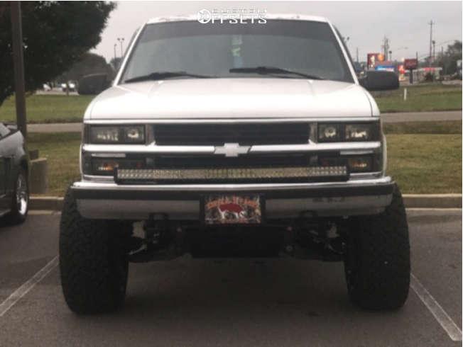 "1995 Chevrolet K1500 Aggressive > 1"" outside fender on 22x12 -51 offset Vision Rocker and 35""x12.5"" Venom Power Terra Hunter X/t on Suspension Lift 6"" - Custom Offsets Gallery"