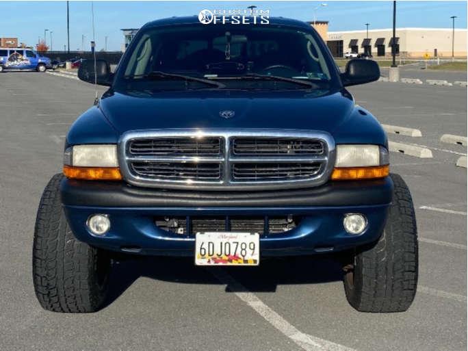 """2004 Dodge Dakota Hella Stance >5"""" on 20x12 -51 offset Vision Rocker & 305/50 Kenda Klever At on Suspension Lift 2.5"""" - Custom Offsets Gallery"""