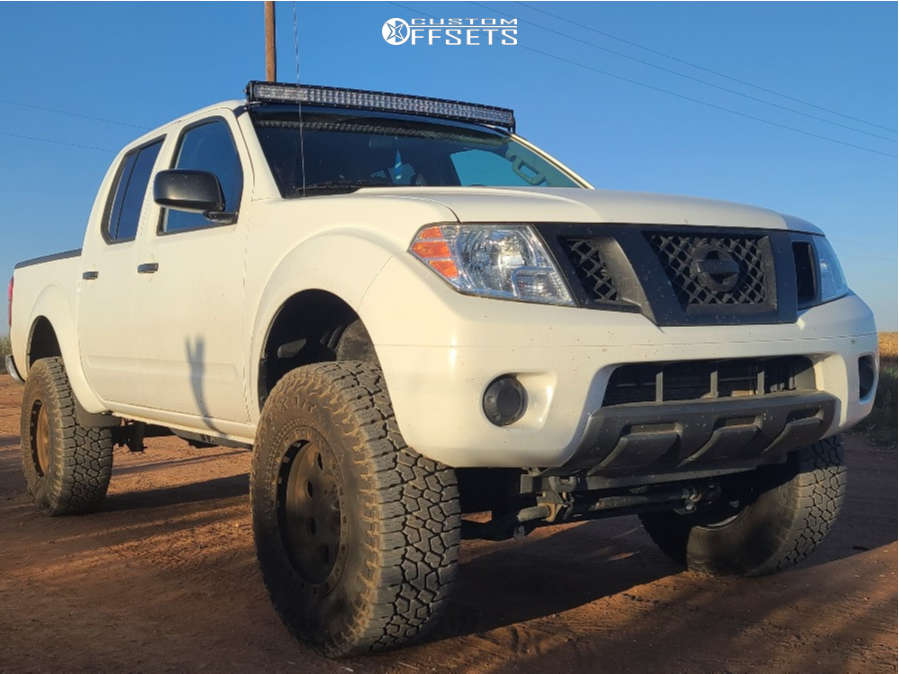 """2016 Nissan Frontier Aggressive > 1"""" outside fender on 18x9 0 offset American Racing Ar201 and 235/70 Falken Wildpeak At3w on Suspension Lift 6"""" - Custom Offsets Gallery"""