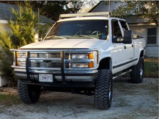 "1999 Chevrolet K2500 Aggressive > 1"" outside fender on 18x10 -24 offset XD Rockstar & 35""x12.5"" Mickey Thompson Baja Mtz P3 on Suspension Lift 6"" - Custom Offsets Gallery"