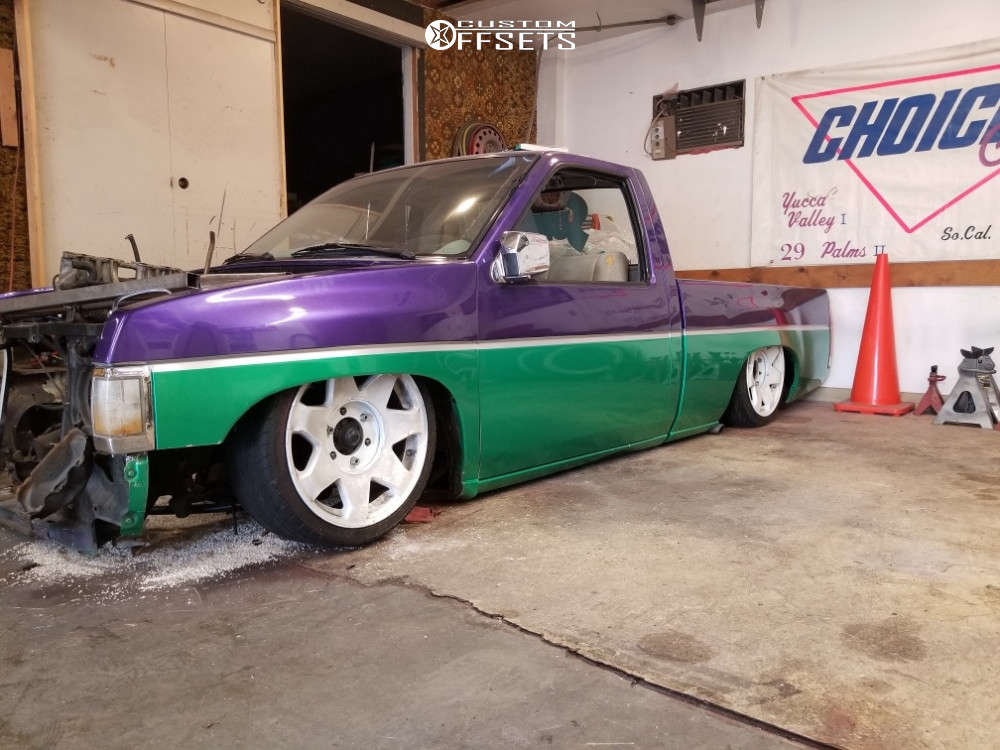 1993 Nissan D21 Tucked on 15x7 -12 offset Weld Racing Super Single and 205/40 Continental All Season on Air Suspension - Custom Offsets Gallery