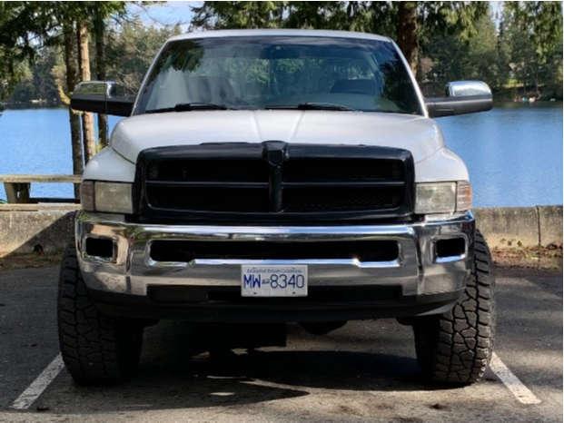 "2000 Dodge Ram 2500 Hella Stance >5"" on 16x12 -50 offset Mickey Thompson Classic Iii and 315/75 Mickey Thompson Baja Atz P3 on Leveling Kit - Custom Offsets Gallery"