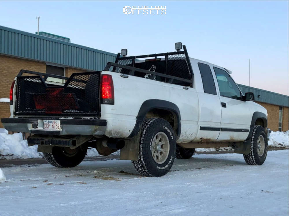 1998 GMC K1500 Slightly Aggressive on 16x8 0 offset Helo He791 and 285/75 Cooper Discoverer At3 Xlt on Stock Suspension - Custom Offsets Gallery