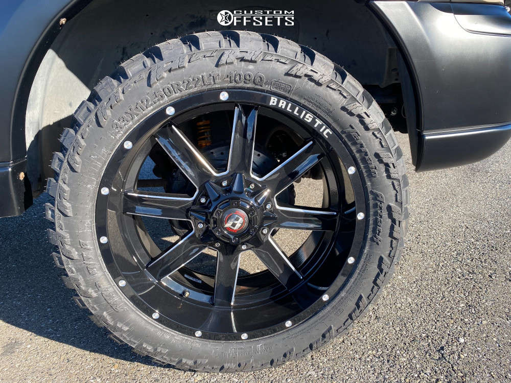 """2000 Lincoln Navigator Aggressive > 1"""" outside fender on 22x10 -24 offset Ballistic Rage & 33""""x12.5"""" AMP Mud Terrain Attack Mt A on Leveling Kit - Custom Offsets Gallery"""