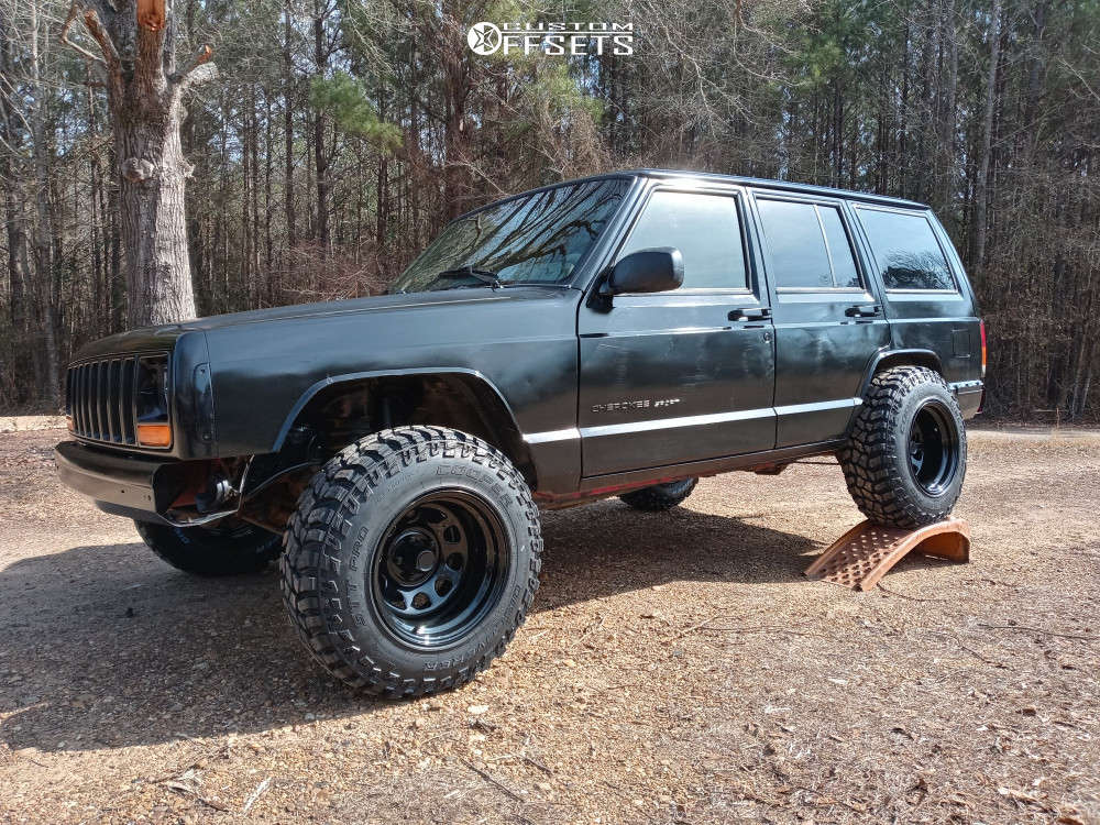 """1999 Jeep Cherokee Super Aggressive 3""""-5"""" on 15x10 -44 offset Pro Comp 51 & 30""""x9.5"""" Cooper Discoverer Stt Pro on Stock Suspension - Custom Offsets Gallery"""