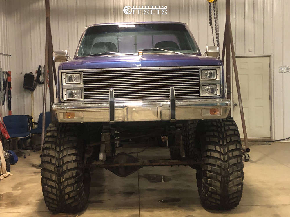 """1981 Chevrolet K30 Hella Stance >5"""" on 20x12 -44 offset Rev Offroad 811 and 44""""x19.5"""" Mickey Thompson Baja Claw on Lifted >12"""" - Custom Offsets Gallery"""