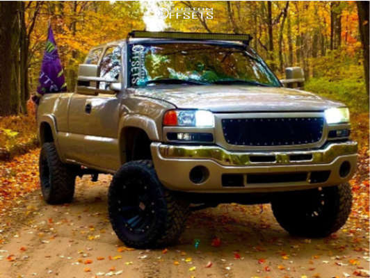 """2004 GMC Sierra 1500 Classic Aggressive > 1"""" outside fender on 18x10 -24 offset XD XD822 Monster and 33""""x12.5"""" Toyo Tires Open Country M/t on Suspension Lift 6"""" - Custom Offsets Gallery"""