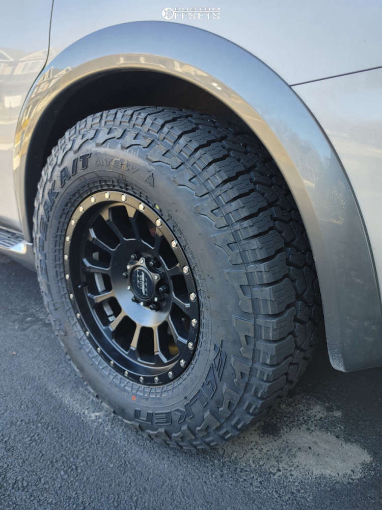 """2017 Nissan Armada Aggressive > 1"""" outside fender on 18x9 0 offset Pro Comp Series 34 & 295/70 Falken Wildpeak At3w on Stock Suspension - Custom Offsets Gallery"""