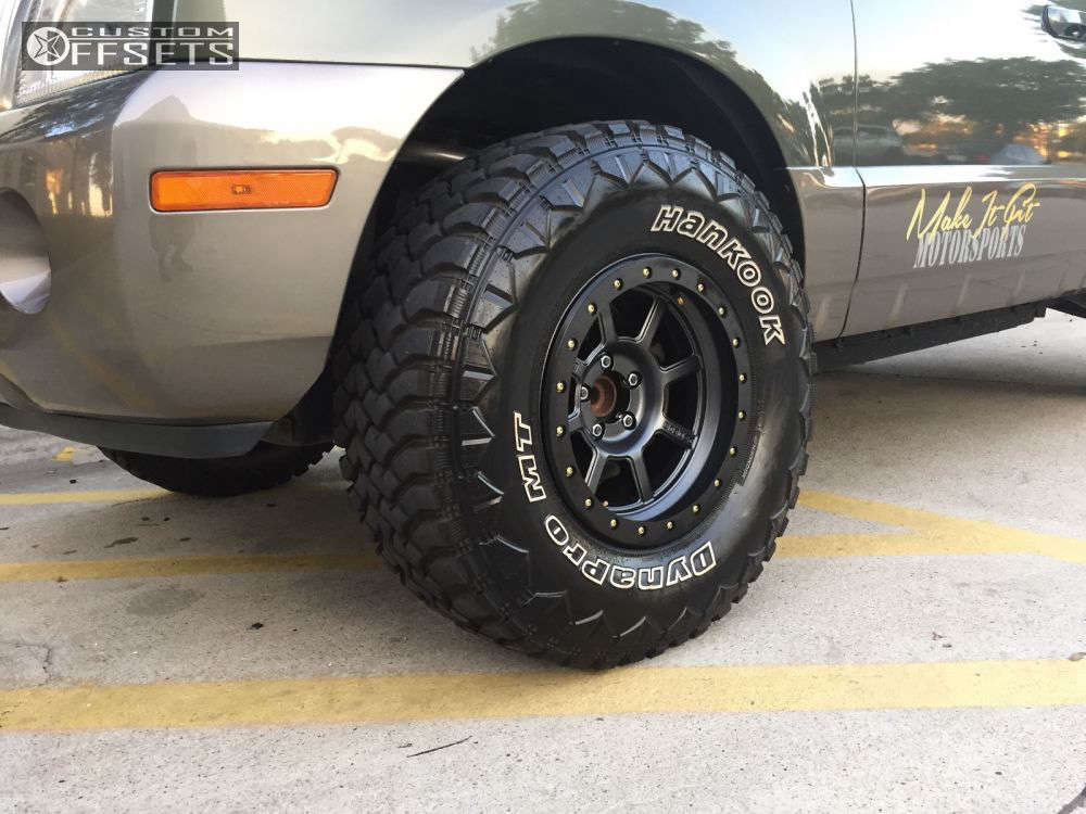 2003 Mercury Mountaineer Slightly Aggressive on 16x8.5 -6 offset Level 8 Bully Pro and 305/70 Hankook Dynapro MT on Stock - Custom Offsets Gallery