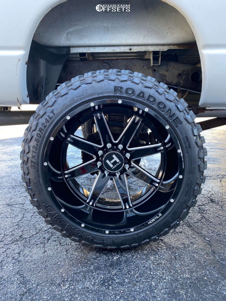 """2008 Dodge Ram 2500 Hella Stance >5"""" on 24x14 -76 offset Hostile H109 and 37""""x13.5"""" Road One Aethon M/t on Suspension Lift 8"""" - Custom Offsets Gallery"""