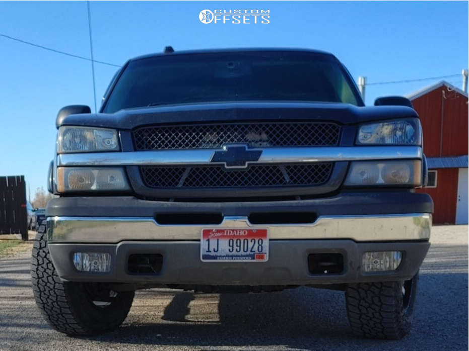 "2005 Chevrolet Silverado 1500 Aggressive > 1"" outside fender on 17x9 -12 offset Moto Metal MO970 and 32""x9.5"" Falken WildPeak AT3W on Stock Suspension - Custom Offsets Gallery"