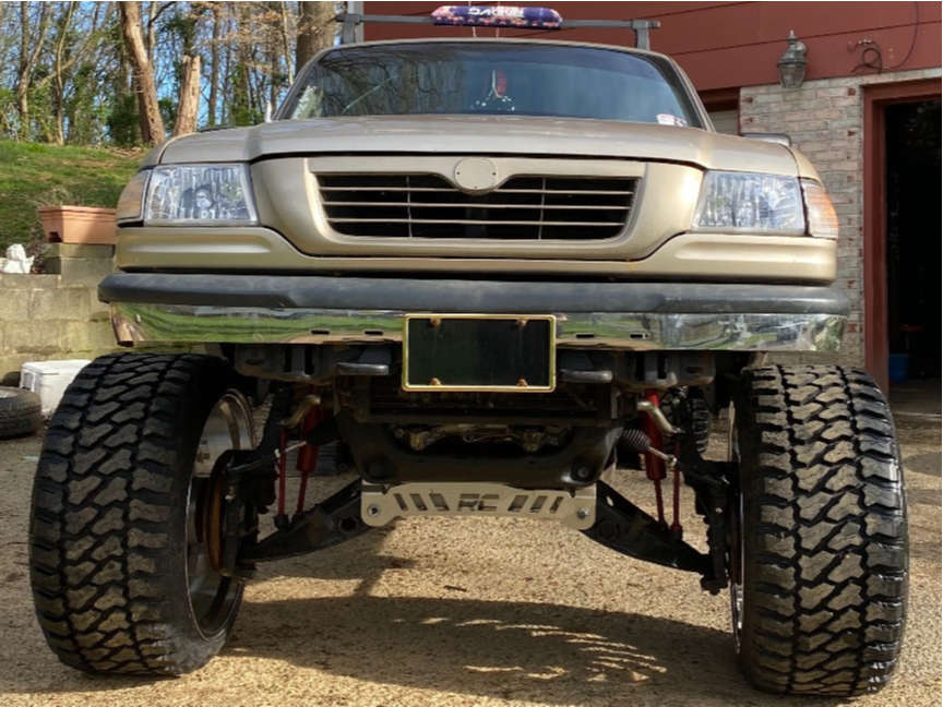 """1999 Mazda B3000 Super Aggressive 3""""-5"""" on 24x14 -81 offset ARKON OFF-ROAD Crown Series Victory & 33""""x14.5"""" Fury Offroad Country Hunter M/t on Suspension Lift 7.5"""" - Custom Offsets Gallery"""