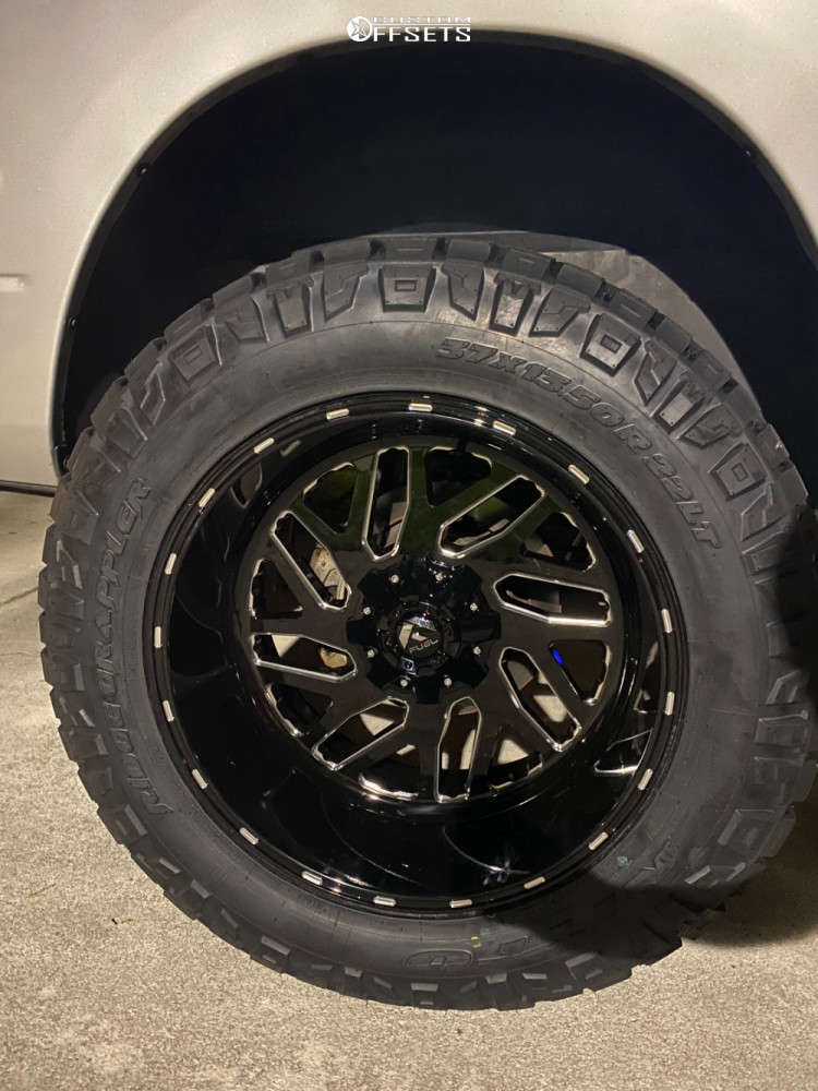 """2011 Ram 1500 Hella Stance >5"""" on 22x12 -44 offset Fuel Triton D581 and 37""""x13.5"""" Nitto Ridge Grappler on Suspension Lift 7"""" - Custom Offsets Gallery"""