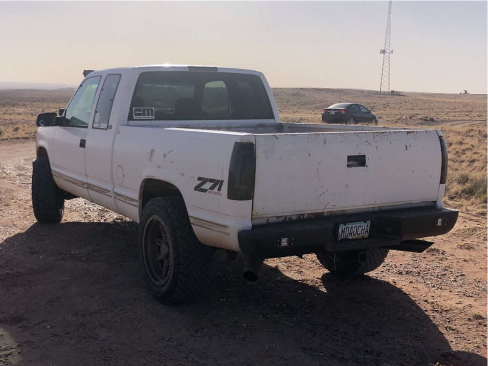 1996 Chevrolet K1500 Slightly Aggressive on 20x10 -18 offset Anthem Off-Road Rogue and 285/55 Venom Power Terra Hunter X/t on Stock Suspension - Custom Offsets Gallery