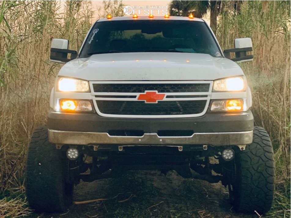 """2007 Chevrolet Silverado 2500 HD Classic Super Aggressive 3""""-5"""" on 24x14 -76 offset Hostile H105 and 36""""x13.5"""" Invovic El523 on Air Suspension - Custom Offsets Gallery"""