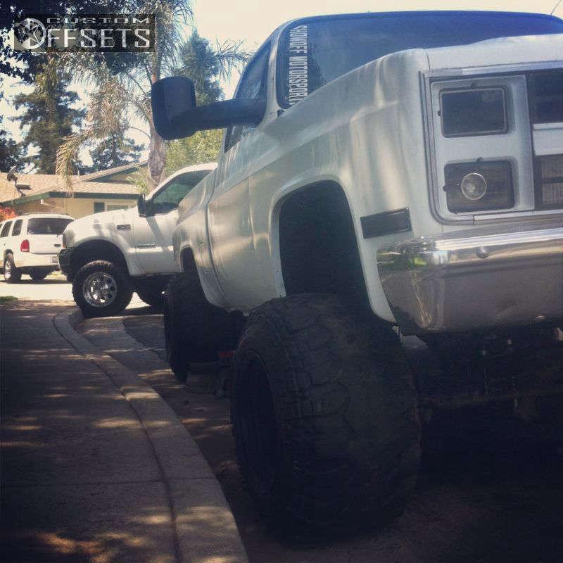 "1984 Chevrolet K10 Hella Stance >5"" on 15x15 -127.6 offset Pull truck wheel Steelie & 31""x13.5"" Super Swamper TSL SX on Suspension Lift 6"" - Custom Offsets Gallery"