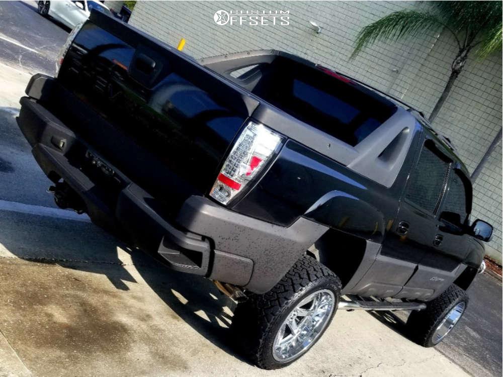 "2004 Chevrolet Avalanche 1500 Aggressive > 1"" outside fender on 22x12 -44 offset Hostile Alpha & 33""x12.5"" Venom Terra Hunter X/t on Suspension Lift 6"" - Custom Offsets Gallery"