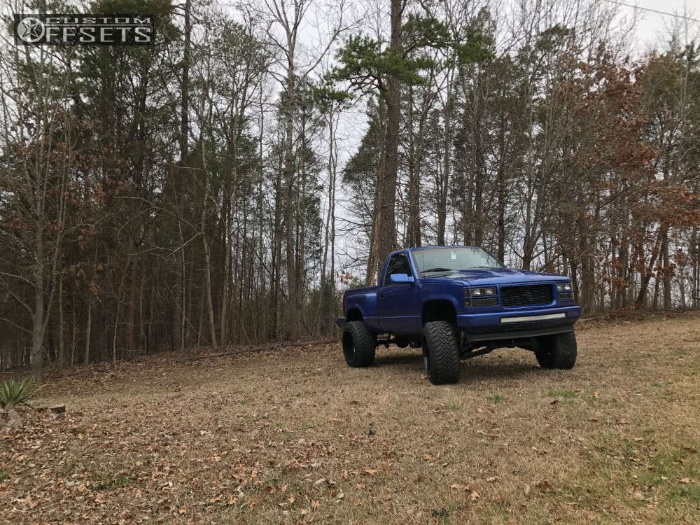 """1995 Chevrolet K1500 Hella Stance >5"""" on 22x14 -76 offset Moto Metal MO962 & 35""""x12.5"""" Toyo Tires Open Country M/T on Suspension Lift 6"""" - Custom Offsets Gallery"""