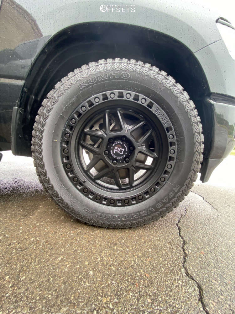 """2021 Ram 1500 Aggressive > 1"""" outside fender on 20x9 0 offset Black Rhino Kelso and 305/55 Kumho Road Venture At51 on Stock Suspension - Custom Offsets Gallery"""