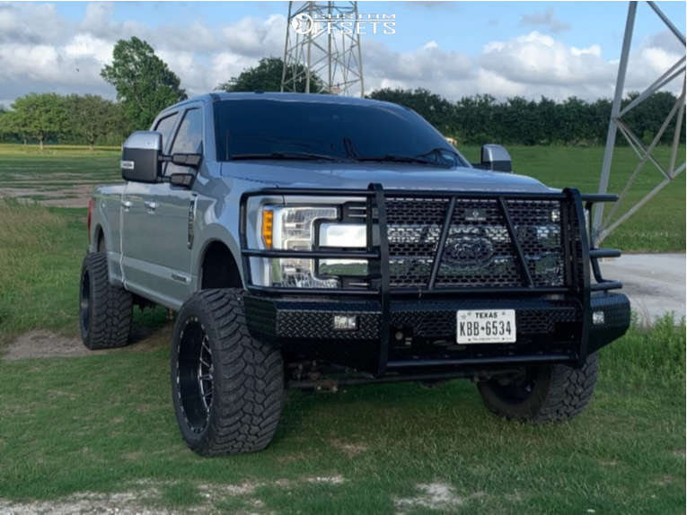 """2017 Ford F-250 Super Duty Aggressive > 1"""" outside fender on 22x12 -44 offset TIS 547bm and 325/50 AMP Mud Terrain Attack M/t A on Leveling Kit - Custom Offsets Gallery"""