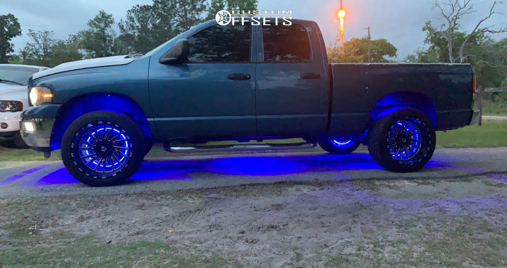 """2002 Dodge Ram 1500 Super Aggressive 3""""-5"""" on 22x12 -44 offset TIS 547bm and 33""""x12.5"""" Toyo Tires Proxes St on Suspension Lift 3"""" - Custom Offsets Gallery"""