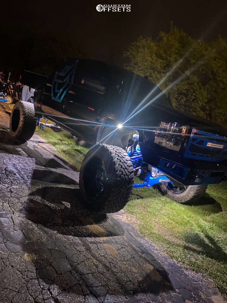"""2014 Chevrolet Silverado 1500 Hella Stance >5"""" on 24x14 76 offset Dropstars 655bm and 40""""x15.5"""" Toyo Open Country M/t on Lifted >12"""" - Custom Offsets Gallery"""