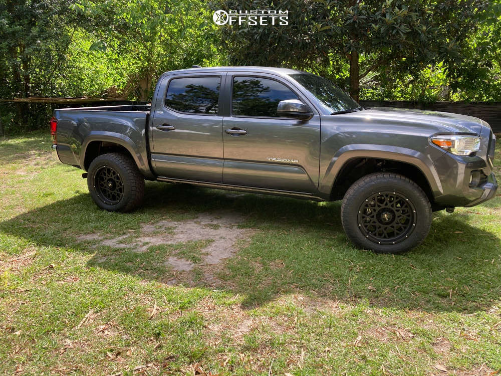 """2021 Toyota Tacoma Aggressive > 1"""" outside fender on 18x9 -12 offset Vision Rocker and 265/10.5 Toyo Tires Open Country A/t Ill on Stock Suspension - Custom Offsets Gallery"""