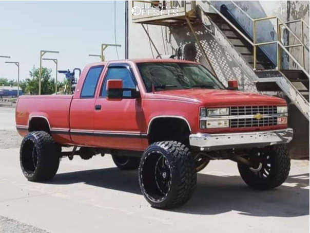 """1990 Chevrolet C1500 Hella Stance >5"""" on 24x14 -76 offset TIS 544bm and 35""""x13.5"""" Amp Mud Terrain Attack M/t A on Suspension Lift 9.5"""" - Custom Offsets Gallery"""
