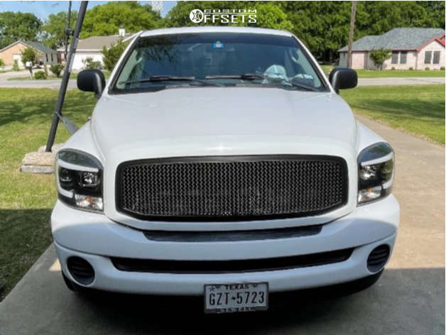"""2006 Dodge Ram 1500 Slightly Aggressive on 20x10 -25 offset KMC Rockstar and 30""""x8.5"""" Toyo Open Country A/t Iii on Level 2"""" Drop Rear - Custom Offsets Gallery"""