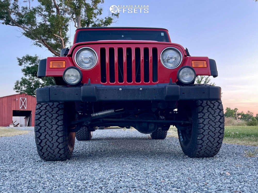 """2004 Jeep Wrangler Aggressive > 1"""" outside fender on 15x8 0 offset Pro Comp 31 and 33""""x12.5"""" General Grabber Atx on Suspension Lift 3"""" - Custom Offsets Gallery"""