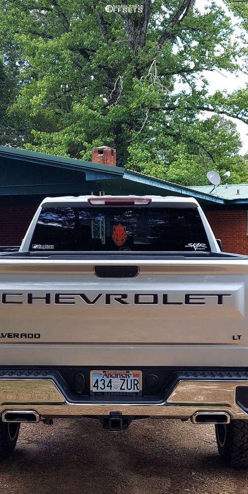 "2019 Chevrolet Silverado 1500 Aggressive > 1"" outside fender on 22x12 -57 offset Vision Sliver and 35""x12.5"" Venom Power Terra Hunter X/t on Suspension Lift 6"" - Custom Offsets Gallery"