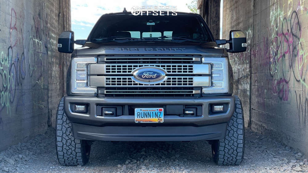 """2019 Ford F-250 Super Duty Aggressive > 1"""" outside fender on 22x12 -44 offset Hostile Jigsaw H116 and 35""""x12.5"""" Toyo Open Country A/t Iii on Suspension Lift 2.5"""" - Custom Offsets Gallery"""