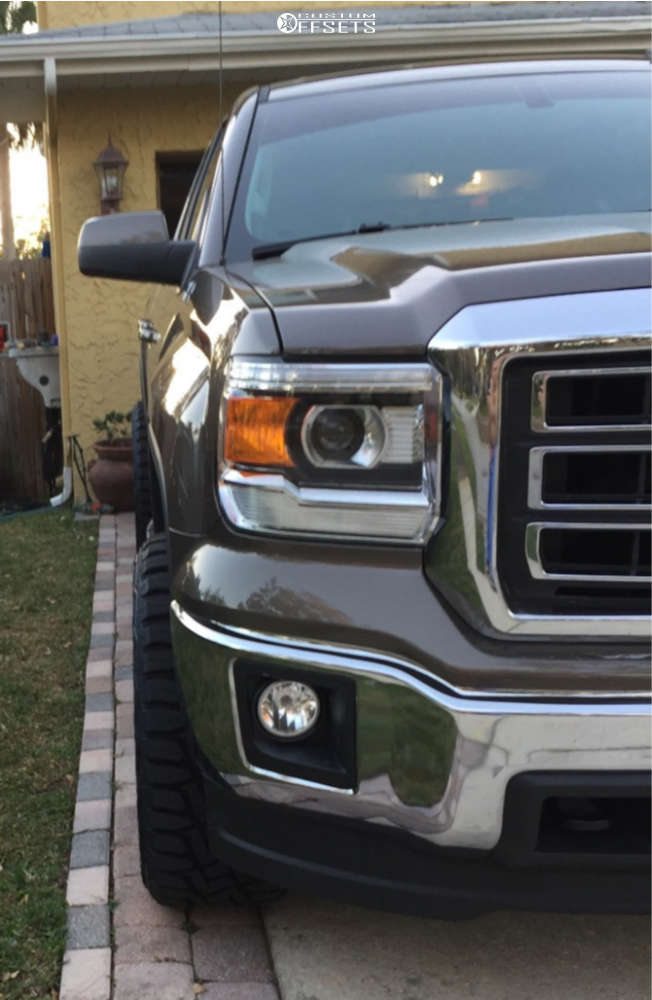 """2014 GMC Sierra 1500 HD Aggressive > 1"""" outside fender on 20x10 -12 offset Fuel Hostage and 33""""x12.5"""" Toyo Open Country R/t on Leveling Kit - Custom Offsets Gallery"""