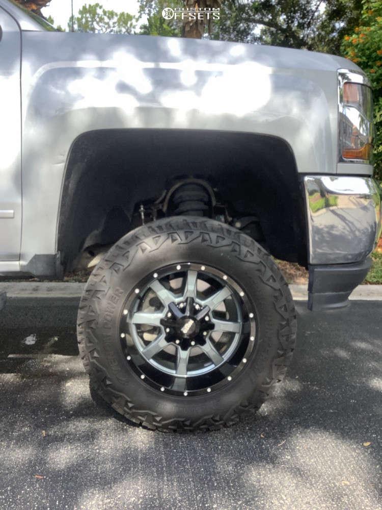 "2018 Chevrolet Silverado 1500 Aggressive > 1"" outside fender on 18x10 -24 offset Moto Metal Mo970 and 33""x12.5"" Venom Power Terra Hunter X/t on Suspension Lift 7"" - Custom Offsets Gallery"