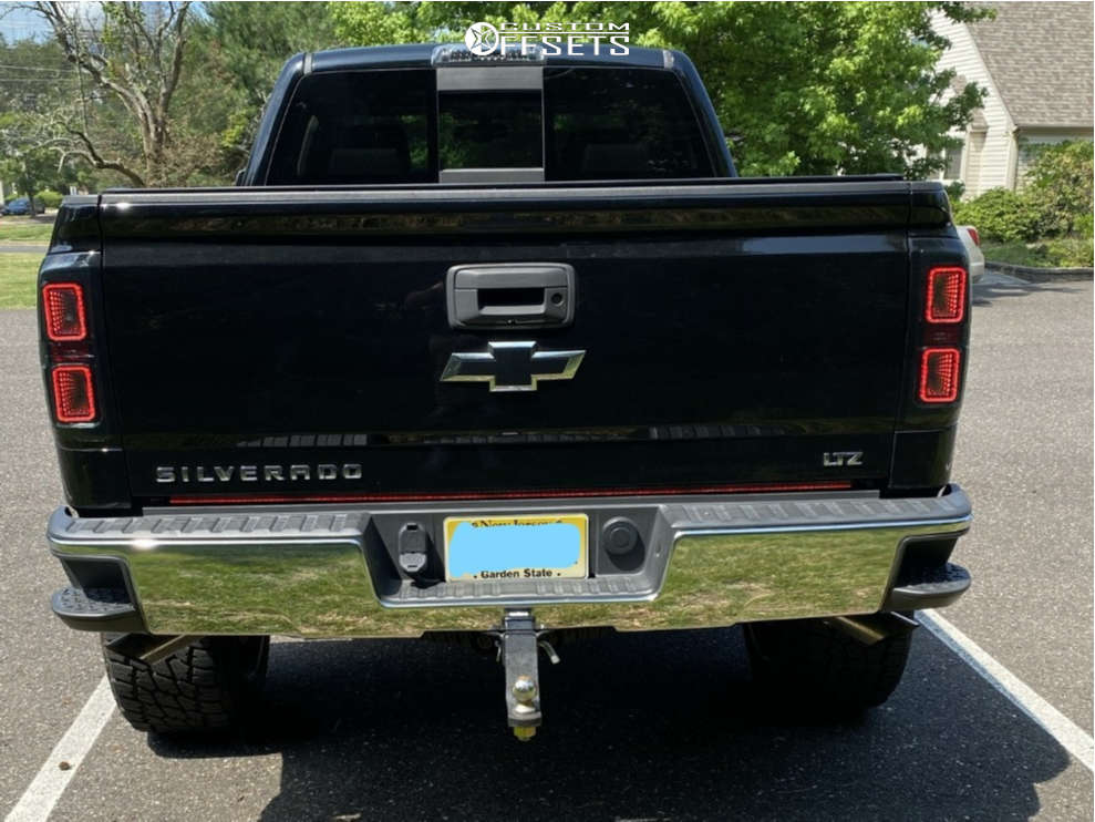 "2018 Chevrolet Silverado 1500 Aggressive > 1"" outside fender on 22x12 -44 offset TIS 548bm and 35""x12.5"" Nitto Terra Grappler G2 on Suspension Lift 7"" - Custom Offsets Gallery"