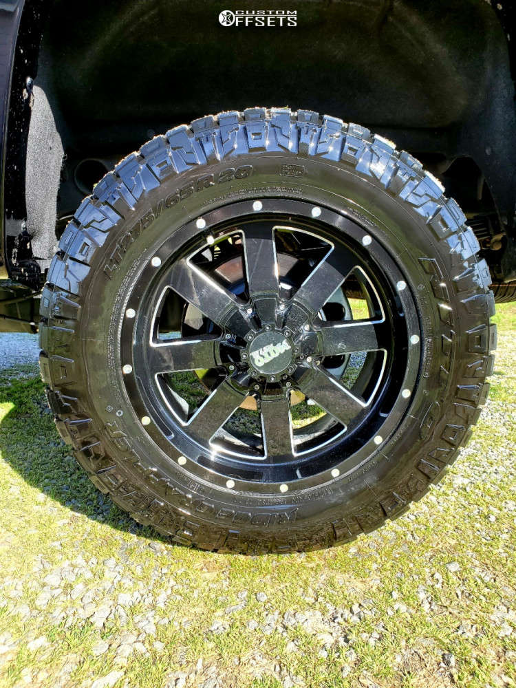"""2019 GMC Sierra 2500 HD Aggressive > 1"""" outside fender on 20x9.5 0 offset Moto Metal Mo962 and 35""""x10.5"""" Nitto Ridge Grappler on Stock - Custom Offsets Gallery"""